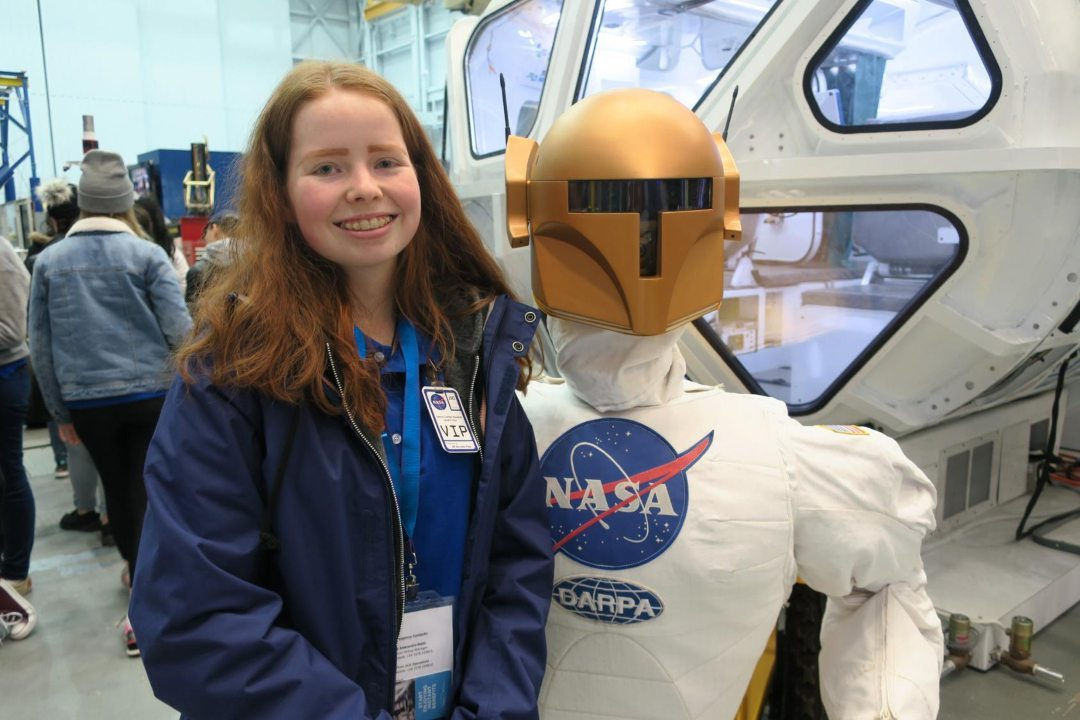 NASA robonaut robot at space school with student