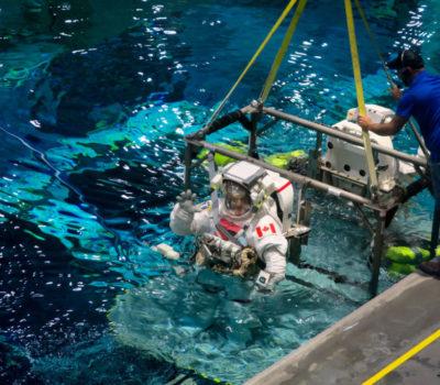 astronauts in water