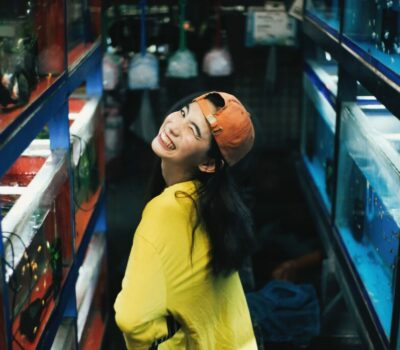 photo-of-smiling-woman-in-yellow-top-and-orange-hat-posing-3208616
